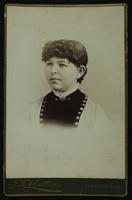 Portrait of a young girl with a frilly collar and black and white dress