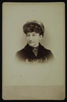 Portrait of a woman with a hat and curly bangs