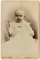 Portrait of a baby in a white dress