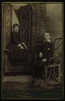 Photo of two children sitting with wood furniture