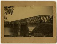 Wooden Bridge with Men Over Kaw River