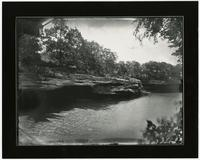Woman with Umbrella on Rock Bank of Wakarusa River