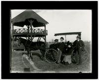 Bismark Grove- Four People With Buggy by Gazebo