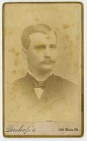 Faded portrait of a man with a mustache
