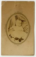 Portrait of a baby framed by an oval mat