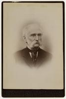 Portrait of an old man with sideburns, mustache, and black tie