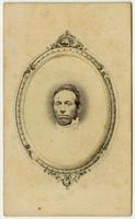 Portrait, small image of a man centered in a decorative oval frame