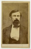 Portrait of a man with dark hair, beard, and mustache