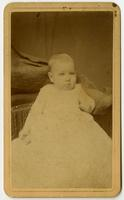 Portrait of an infant in a long white dress