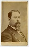 Portrait of a portly man with a beard and mustache