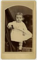 Portrait of infant with white dress and striped leggings