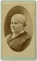 Portrait of a portly old woman with tied back hair and haircomb