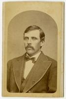 Portrait of a man with a mustache and a striped suit jacket