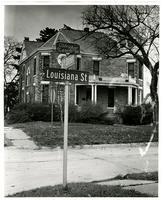 615 Louisiana and Street Sign