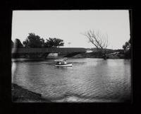 Boat Celeste? on river near bridge