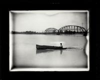 Bridge and man in boat