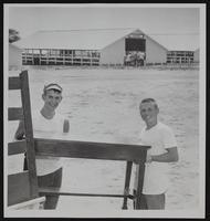 4H Fair - Fairgrounds readied for Fair. Harry Craig (left) and Chuck Broadwell.